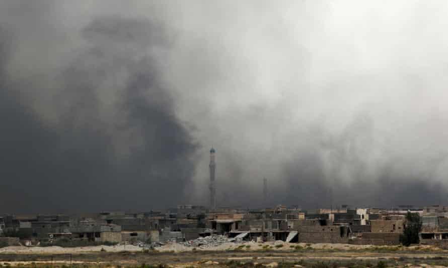 Smoke billows from Fallujah's southern Shuhada neighbourhood following shelling.