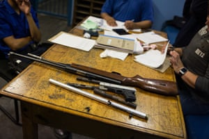 Confiscated home-made firearms are booked into evidence at the Grassy Park police station in Cape Town