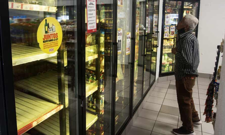 A man looks for a soda drink as shelves sit empty following the shortage of beer in Monterrey, Nuevo León state, Mexico, on 5 May.