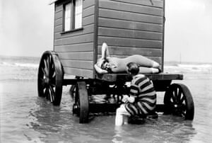 Swimmers on a bathing hut, about 1900.