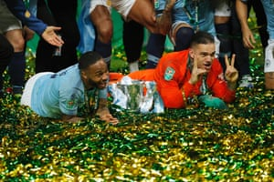 Sterling and Ederson with the cup