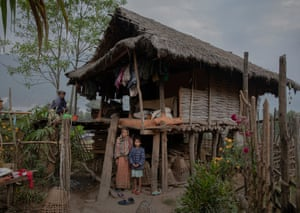 Girl with couple under wooden house on stilts