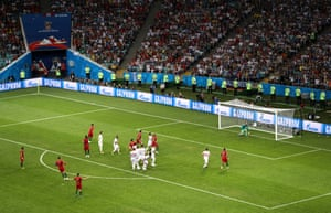 Portugal's Cristiano Ronaldo scores his third goal from a free-kick against Spain at Fisht Stadium.