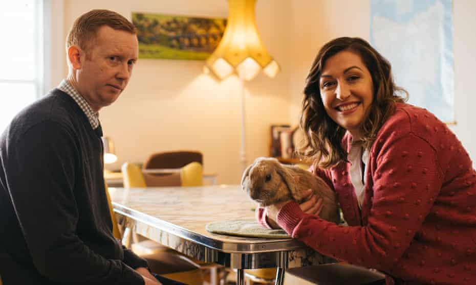 Daniel (Luke McGregor), rabbit Lord Fluffington and Emma (Celia Pacquola) in season four of Rosehaven.
