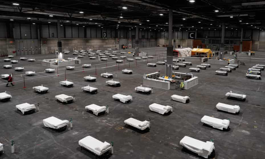 Beds arranged at a military field hospital at an exhibition complex in Madrid.