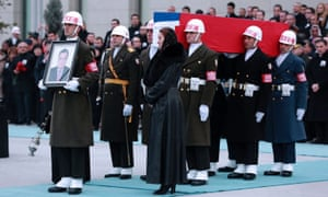 Turkish forces carry the Russian flag-draped coffin of Andrei Karlov during a ceremony at Ankara's Esenboga airport.