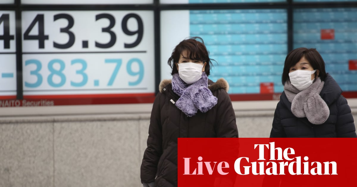 Stocks and oil slide on fears over China virus outbreak – business live