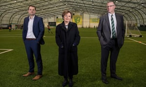 Norwich City's sporting director Stuart Webber (left), owner Delia Smith and managing director Steve Stone (right) at the club's academy indoor arena.