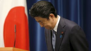 Shinzo Abe bows as he leaves a news conference after delivering a statement marking the 70th anniversary of the end of the second world war