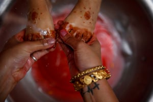 A girl's feet are washed before being decorated as the living goddess Kumari