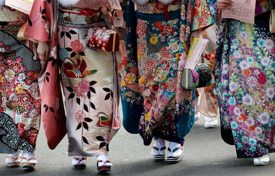 Japanese women wear kimonos attend their Coming of Age Day celebration ceremony.