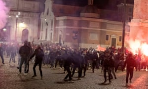 Riot police and members of far-right group Forza Nuova clash during a protest against the prospect of new coronavirus restrictions, in Piazza Del Popolo, Rome, Italy, 25 October 2020.