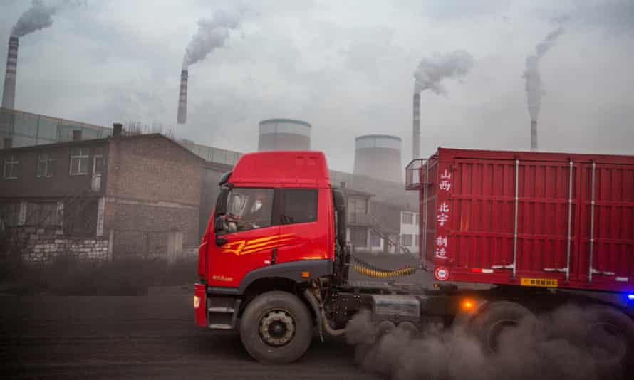 Trucks deliver coal to Datong No 2 power station in China