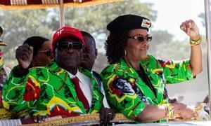 Zimbabwe's president Robert Mugabe, left, with wife Grace.