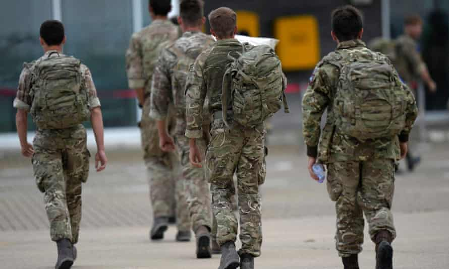 Members of 16 Air Assault Brigade walk to the air terminal at Brize Norton, Oxfordshire on 28 August after assisting with the evacuation from Kabul.