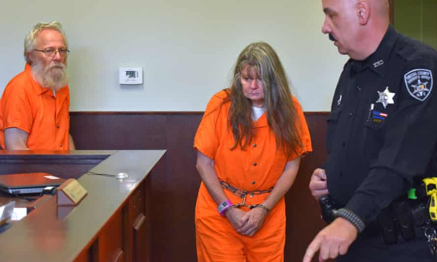 Bruce Leonard, left, and Deborah Leonard, center, enter the courtroom before their arraignment on Tuesday in New Hartford, New York.
