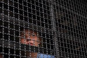 Belarusian model Anastasia Vashukevich looks through a prison van in Bangkok.