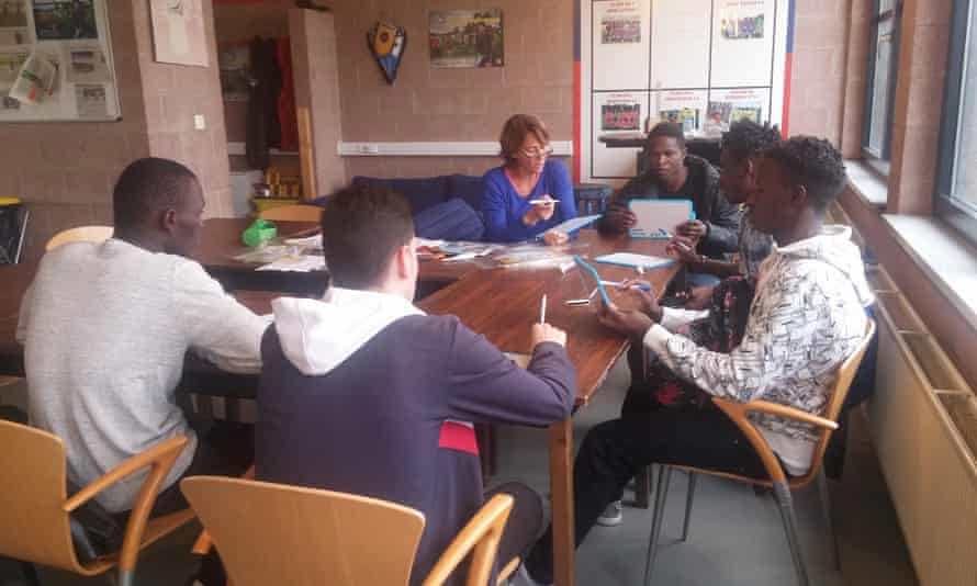 Refugees learning French.
