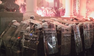 Riot police forming a shield against projectiles during an anti-government protest in Belgrade.