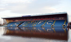 Flood water covers the pitch and some of the stands at Carlisle United FC's Brunton Park stadium in Carlisle.