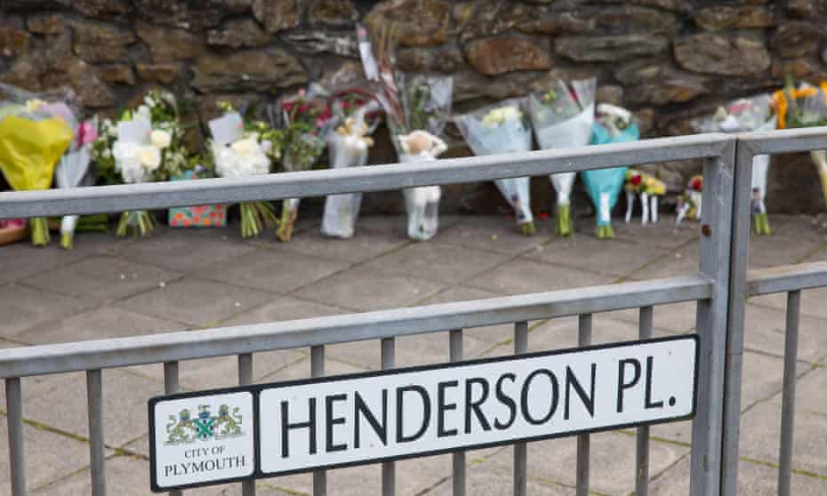 Flowers laid at Henderson Place, near the scene of the shootings in Plymouth.