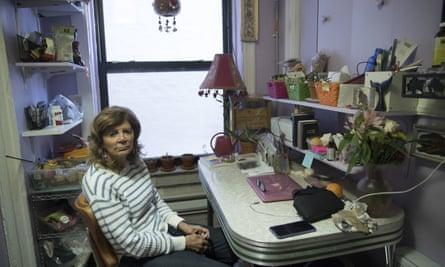Mary Ann Siwek sits in her apartment in the East Village neighborhood of Manhattan.