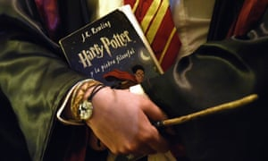 a Harry Potter fan arrives with a wand and a Harry Potter book