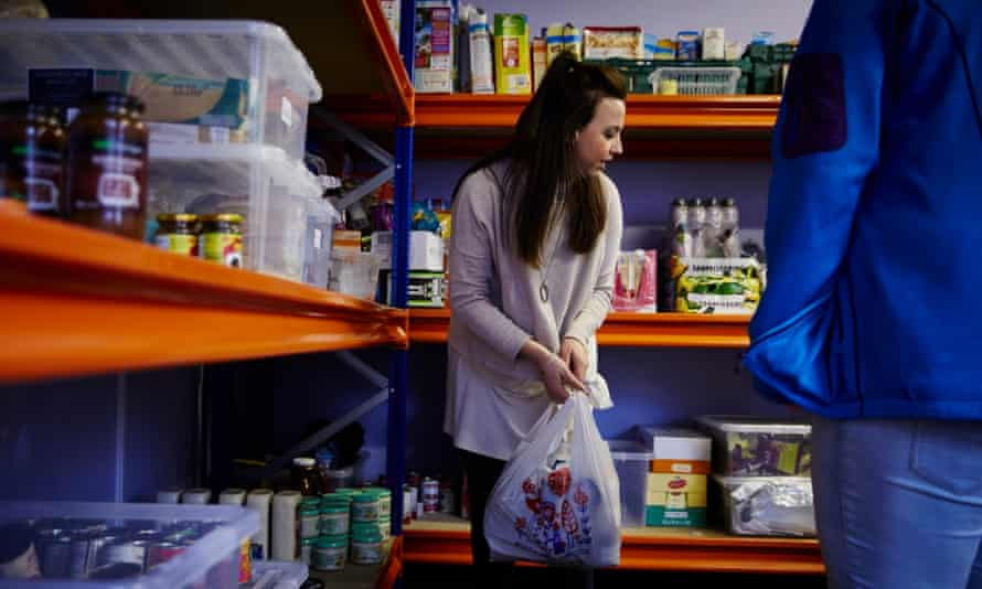 Charity worker Laura Eccles hands out parcels from the food bank