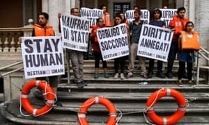 Activists protest against the Italian government's policy towards migrants in Rome on Wednesday.