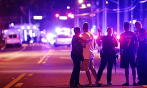 An Orlando Police officer directs family members away from a fatal shooting at Pulse nightclub in Orlando, Florida, in June 2016.
