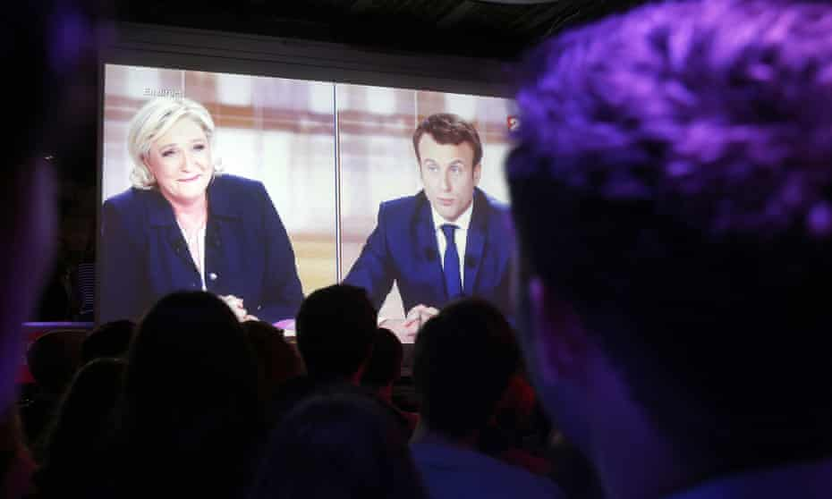People in Paris watch the TV presidential election debate between Emmanuel Macron and Marine Le Pen on 3 May 2017