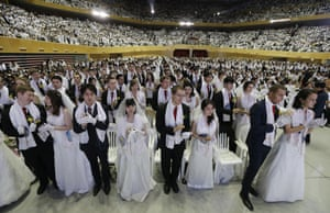 Couples from around the world participate in a mass wedding ceremony of the Unification Church.