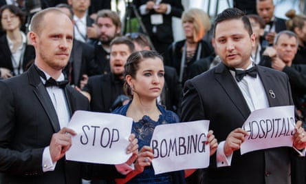 Co-director Edward Watts, Waad al-Kateab and her husband Hamza take their message to the Cannes film festival earlier this year.
