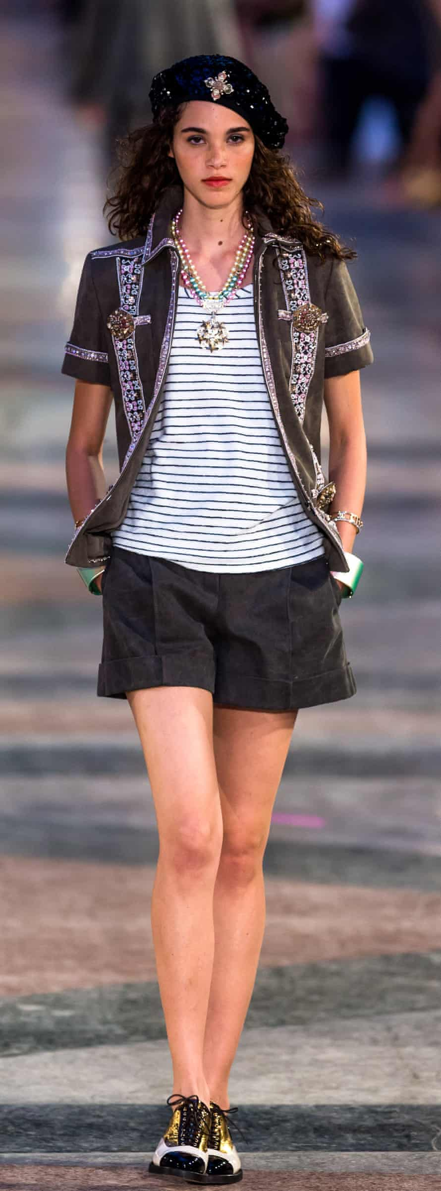 A model wears a Che inspired beret on the catwalk at the Chanel fashion show.