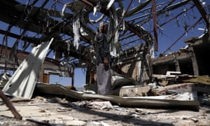 A man stands in the ruins of a hall hit by airstrikes in October  in Sana'a, Yemen.