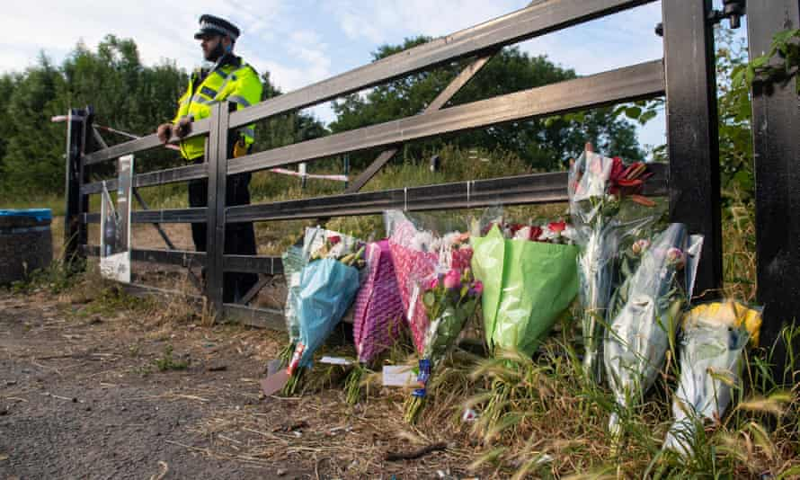 Flowers at an entrance to Fryent Country                         Park, in Wembley, north London, where Nicole                         Smallman and Bibaa Henry were killed.