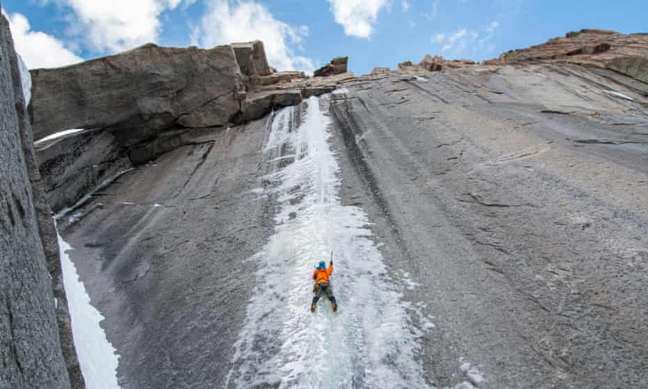 A climber leads a difficult first ascent of an ice climb in early autumn.