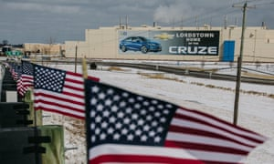 Flags fly in front of Lordstown's GM production plant