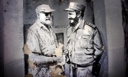 A mural featuring Hemingway shaking hands with Fidel Castro decorates a wall in a car park in Havana.
