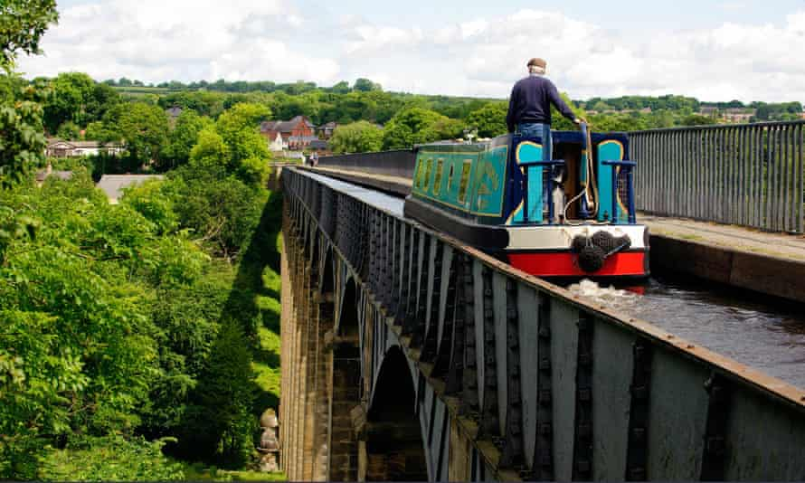 A barge travelling over the Pontcysyllte aqueduct on the Llangollen canal