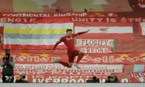 Alex Oxlade-Chamberlain celebrates Liverpool's fifth goal against Chelsea the night the Reds were crowned champions