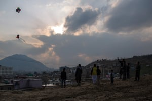 Boys take to the hills surrounding Kabul, where they fly their colourful kites.