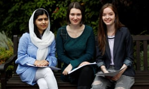 Malala Yousefzai poses with fellow students Bethany Lucas and Beatrice Kessedjian after collecting her A-level exam results at Edgbaston High School for Girls in Birmingham.