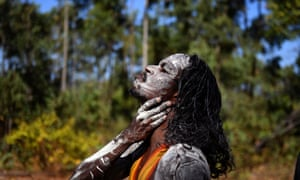 A member of the Gumatj clan of the Yolngu people from north-eastern Arnhem Land prepares for the Bunggul traditional dance at the Garma festival on Friday