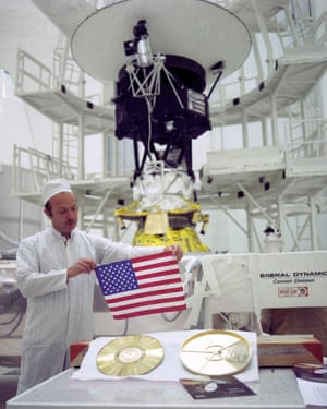 As the two Voyagers travel into deep space, they carry a small American flag and a golden record packed with pictures and sounds – mementos of Earth