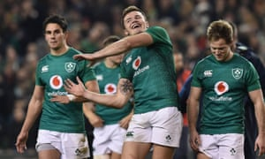Jacob Stockdale and his Ireland teammates celebrate after their seismic victory over Steve Hansen's New Zealand in Dublin.