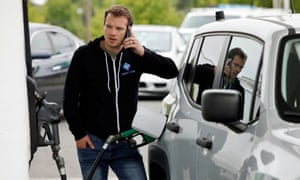 A motorist fills up his car at a gasoline station during a surge in demand for fuel following the cyber-attack that crippled the Colonial Pipeline.