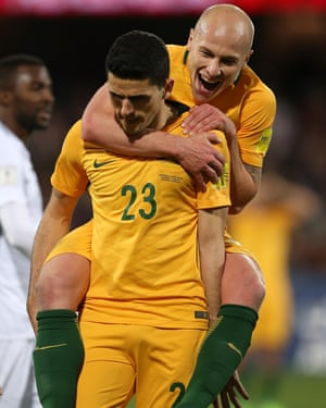 Tomas Rogic and Aaron Moody celebrate.