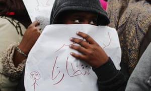 A child protests in the Calais refugee camp