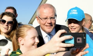 Scott Morrison stops for a selfie on election day. The Liberals dominated on Facebook with its videos watched three times as much as Labor's